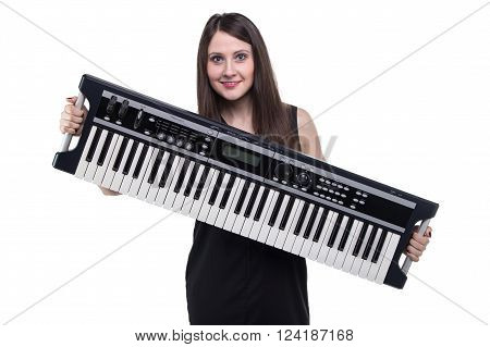 Brunette woman holding synthesizer on white background