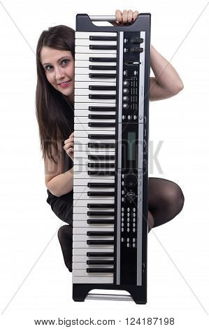 Smiling sitting woman with synthesizer on white background
