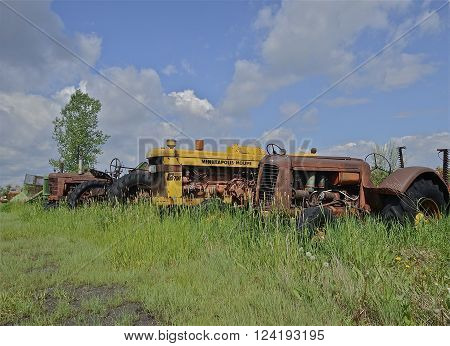 BARNESVILLE, MINNESOTA, June 2, 2014: A Minneapolis Moline tractor in a junkyard is a product of Minneapolis-Moline, a large tractor and machinery producer based in Minnesota. It was the product of a merger between three companies in 1929: