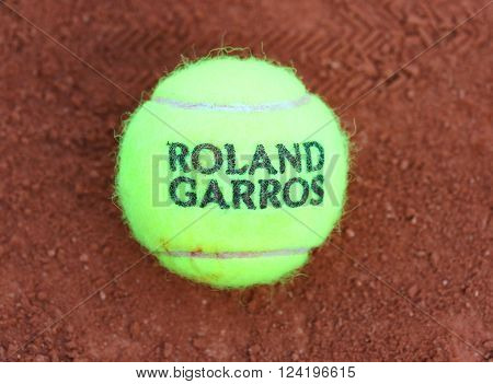 PARIS, FRANCE- MAY 24, 2015: Babolat Roland Garros 2015 tennis ball at Le Stade Roland Garros in Paris, France. Babolat is an Official Partner of the tournament and provides racquets, balls, strings