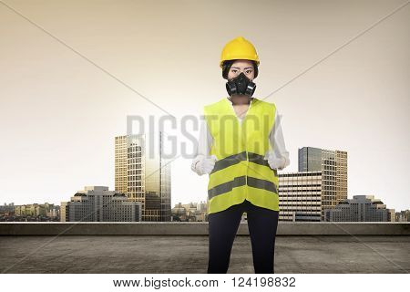 Asian Woman In Safety Vest Posing