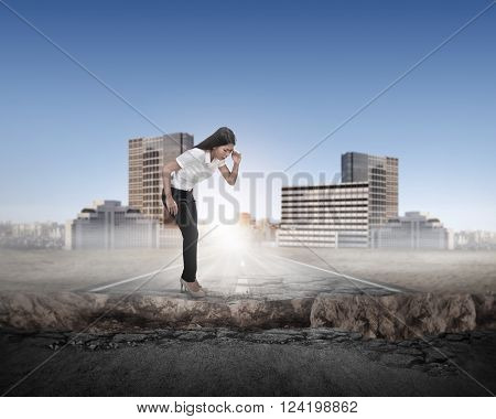 Business Woman Looking Down On Broken Road