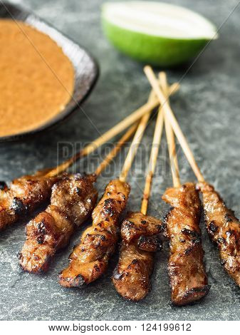 close up of rustic indonesian satay meat skewer