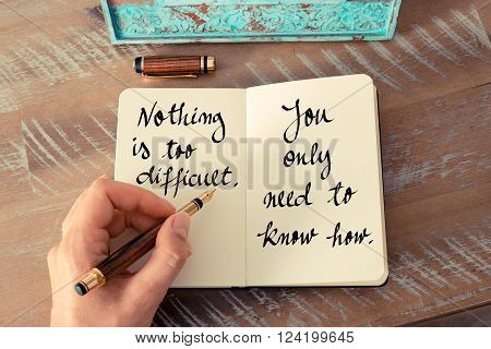 Retro effect and toned image of a woman hand writing on a notebook. Handwritten quote Nothing is too difficult. You only need to know how as inspirational concept image