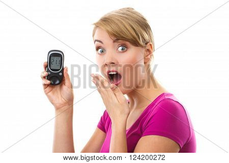 Shocked and worry woman holding glucose meter with bad result of measurement sugar level, concept of diabetes, checking sugar level