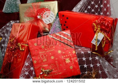Christmas presents in beautiful wrapping paper - x-mas