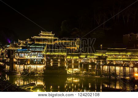Fenghuang (Phoenix) the ancient town at night time Hunan province China.