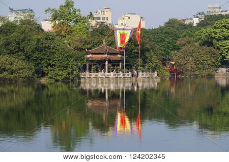 HANOI, VIETNAM - DECEMBER 13, 2015: Sword lake and temple jade on a sunny day. The historic landmark of the city of Hanoi, Vietnam