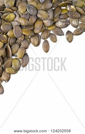 Unshelled pumpkin seeds border over white background