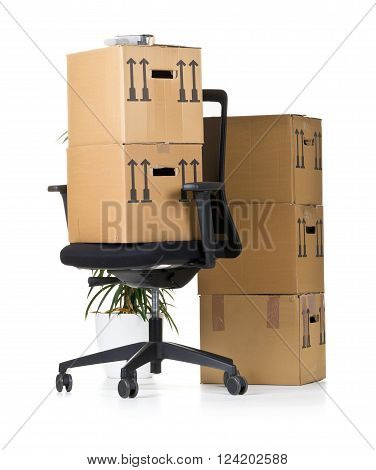 Moving boxes on office chair over white background - office moving or relocation concept