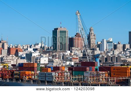 Montevideo Uruguay - December 15 2012: Montevideo cityscape from port district - Containers at the port on the ship in the foreground at Montevideo Uruguay.