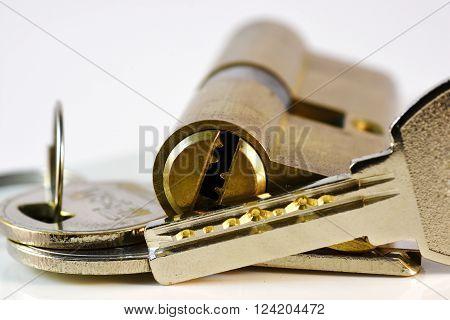 Close up keys and lock Cylinder on white background