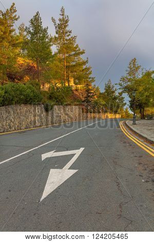 Road in Troodos mountains with painted arrow, Cyprus