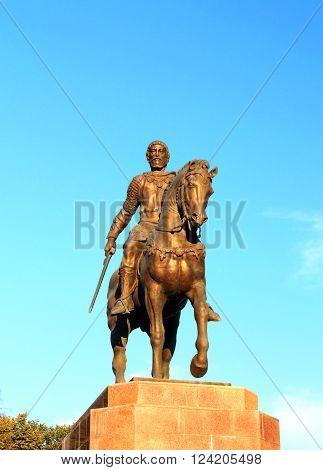 RYAZAN REGION  AUGUST 16: Bronze sculpture of a rider and his war horse - on August 16, 2015  in Ryazan region