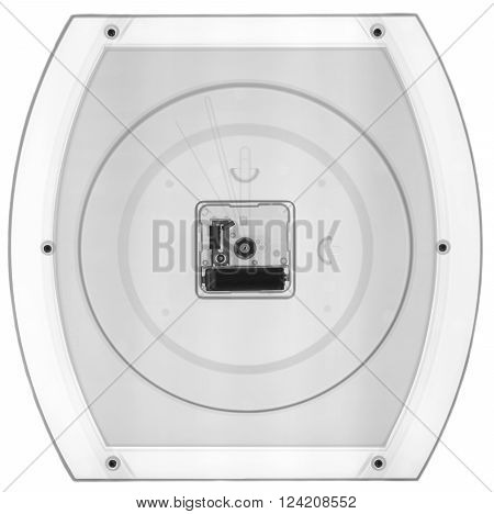 Wall clock under X-rays in black tones. Rontgen, fluoroscopic image.