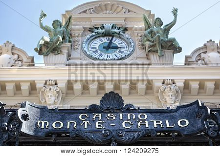 Monte Carlo, Monaco - September 21, 2013: Front entrance canopy, sign and clock tower of the famous casino at Monte Carlo, Monaco.