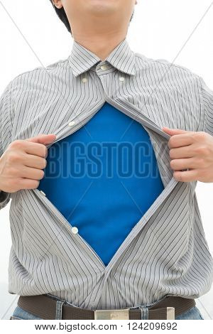 businessman showing superhero suit underneath his shirt