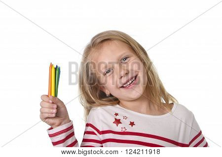 6 or 7 years old beautiful little girl holding multicolor crayons set in art school children education concept isolated on white background