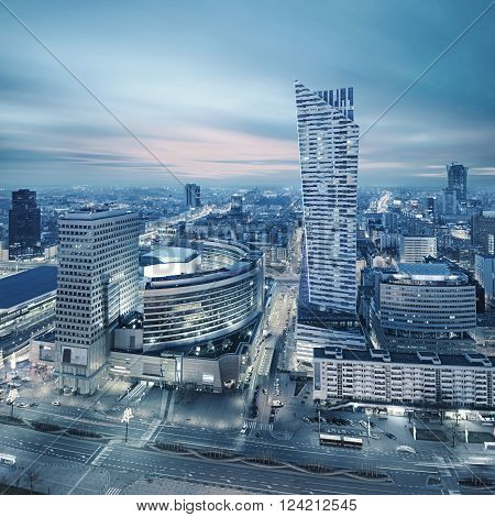 Night view of Warsaw modern business district from viewpoint of Culture and science palace. Creative silver toning effect