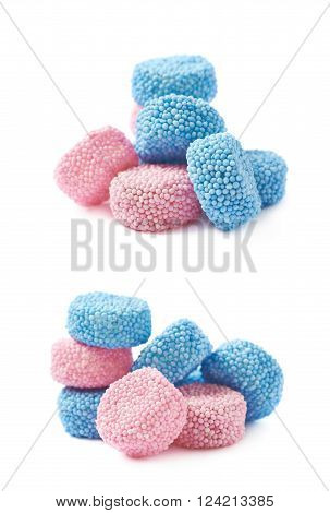 Pink and blue gelatin based cylinder shaped candies composition, isolated over the white background, set of two different foreshortenings
