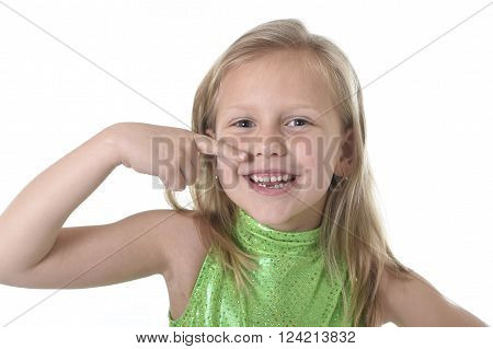 6 or 7 years old little girl with blond hair and blue eyes smiling happy posing isolated on white background pointing mouth in language lesson for child education and body parts school chart serie