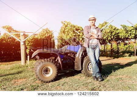 Man standing next to truck in vineyard