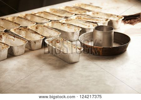 Set Of Baking Pan Molds For Cake Setted Up On Stone Marble Table And Ready To Be Filled With Cake Ba