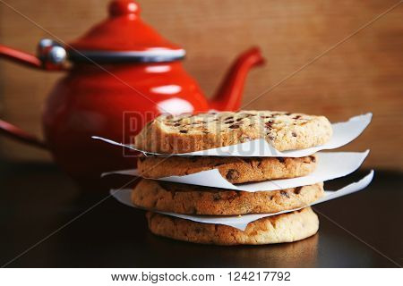 Tasty Homemade Crunchy Cookies  In Front Of Unfocused Aged Teapot From Red Enamel Steel, With Hot Be