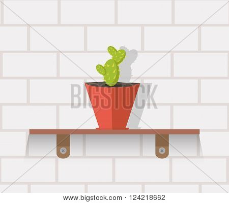 Houseplant design flat concept. Vase with cactus on shelf against wall of brick