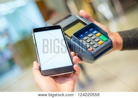 Customer using mobile phone for payment