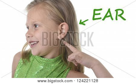 6 or 7 years old little girl with blond hair and blue eyes smiling happy posing isolated on white background pointing ear in learning English language school education body parts card set