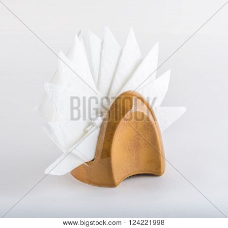 Table napkin holder with white napkins on white background