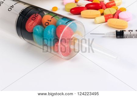 Close Up Of A Syringe And Candy On White Background. Protect Against Diabetes.