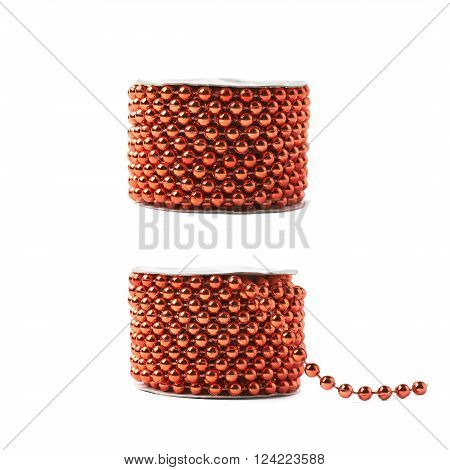 Small red beads garland thread on a reel isolated over the white background, set of two different foreshortenings