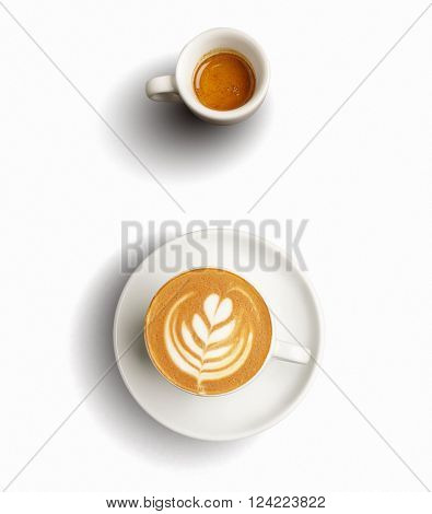 Isolated on white set of two ceramic cups with aromatic freshly brewed espresso and cappuccino