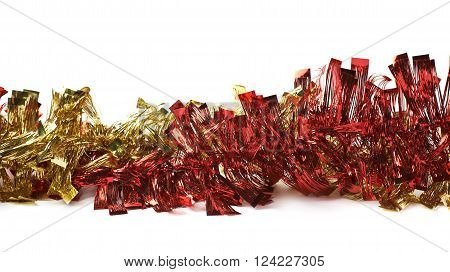 Line of a golden and red tinsel decorational Christmas garland isolated over the white background