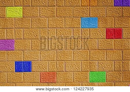 Painted brick wall background with different colored bricks abstract pattern colorful fun design.