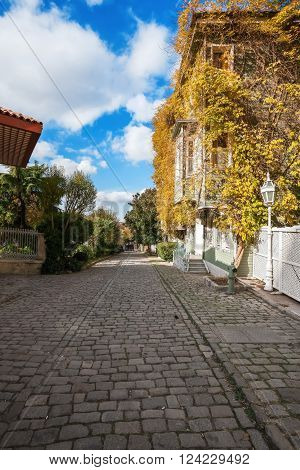 Istanbul - Turkey. Autumn street, Soguk cesme. Beautiful blue sky with clouds.