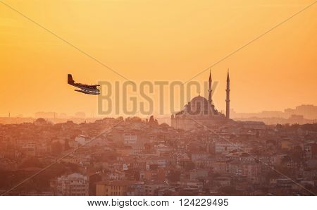 Turkey, Istanbul. November 19, 2013: Seaplane flying over the city with a view of the mosque.