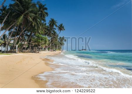 Unidentified people on the beach at Hikkaduwa. Hikkaduwa's beach and night life make it a popular tourist destination.