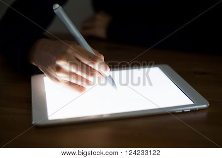 Woman using pen write on tablet pc