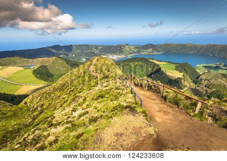 Walking path leading to a view on the lakes of Sete Cidades and Santiago in Sao Miguel Azores