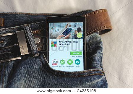 SARANSK, RUSSIA - April 3, 2016: Photo of Smartphone in a jeans pocket with AVG antivirus application in a Google Play Store on the screen.