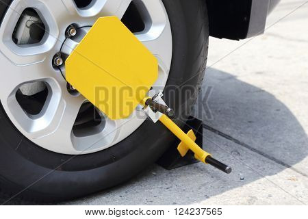 clamped front wheel with yellow wheel lock