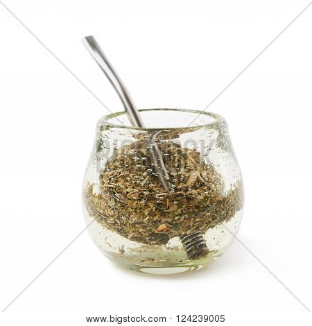 Glass mate calabash vessel filled with a mate tea and bombilla drinking straw inside it, composition isolated over the white background