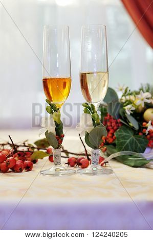 Two glasses of champagne on wedding table