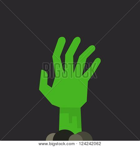 Green undead zombie hand raised up from the ground isolated on dark background