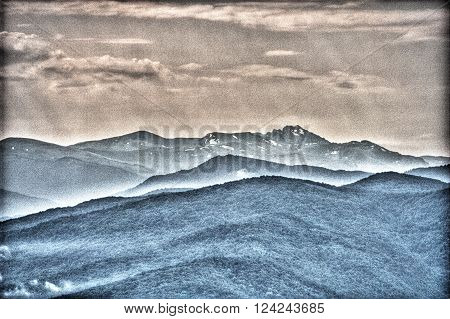 Mountains in surreal grunge style. Background image