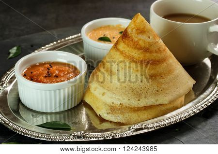 Cone shape Masala Dosa with Sambar and chutney south Indian breakfast