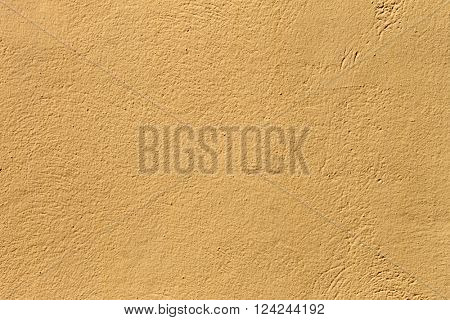 Abstract textured yellow stone background.